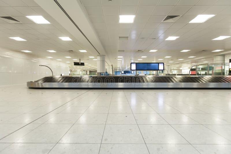 Airport baggage claim. Airport interior at baggage claim stock image