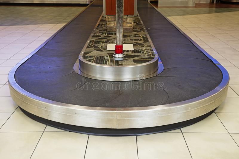 Airport Baggage Reclamation Area. With curved empty luggage belt royalty free stock images