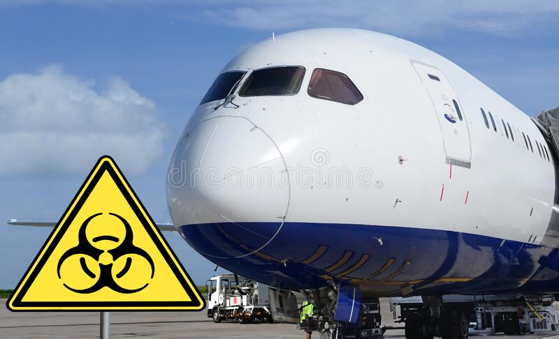 Airport. Bio-hazard sign in-front of airplane. stock photography