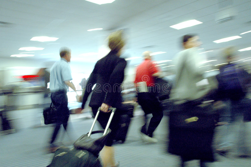 Airport blurs 4. A woman rushes through the crowd to her gate. Attention: visible noise stock image