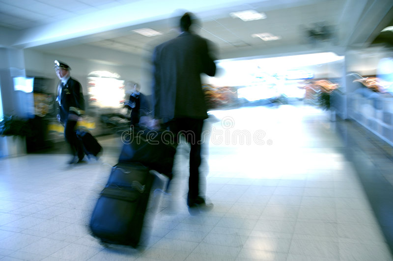 Airport Blurs 5. Business man and a pilot pass each other as they move towards opposite terminals