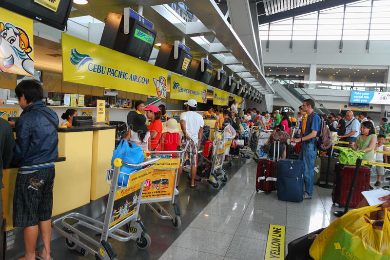 Airport check-in counters Manila, Philippines. Ninoy Aquino International Airport, Philippines -August 9, 2012: A daily busy scene in the check-in counter on royalty free stock photography