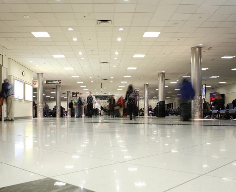 Airport concourse. Movement theme - people faces are blurred royalty free stock photos