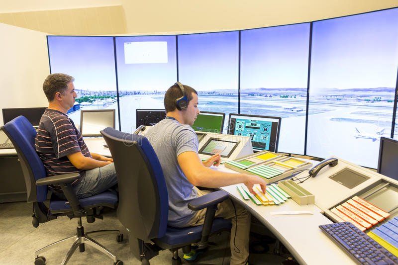Airport control room. Sofia, Bulgaria - September 12, 2016: A controller in Bulgarian Air Traffic Services Authority`s surveillance control room is navigating stock image