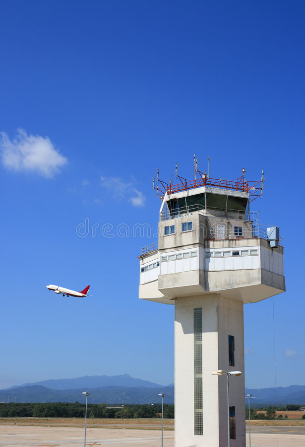 Airport control tower. And airplane taking-off stock photo