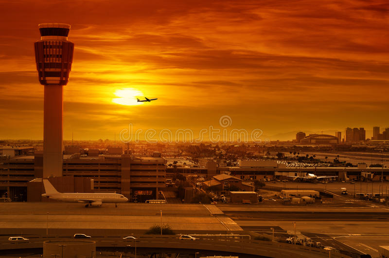 Airport control tower. And airplane taking off at sunset stock photos