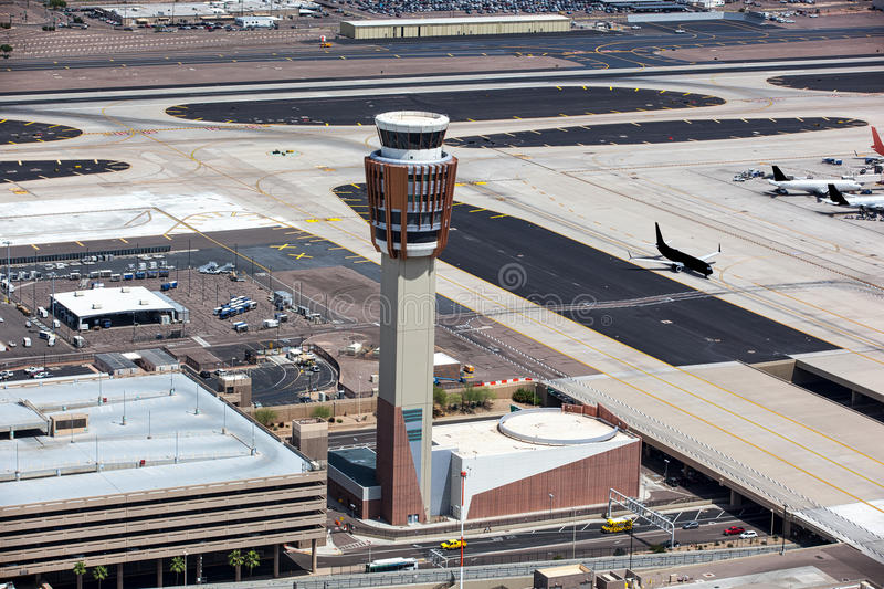 Airport Control Tower. Busy Airport Control Tower viewed from above directing arriving and departing flights stock images