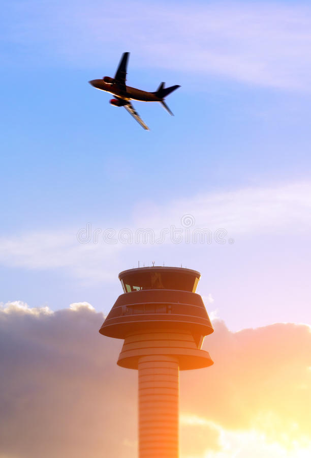 Airport control tower. Passenger airplane stock photo