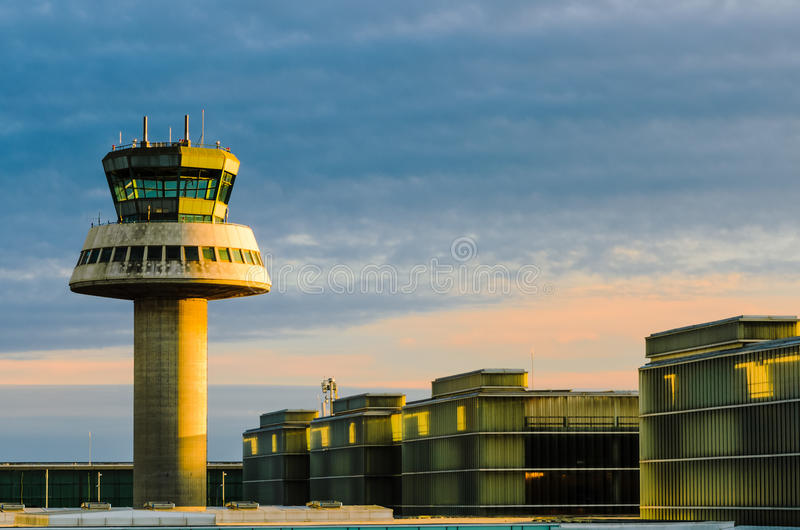 Airport control tower at sunset stock image