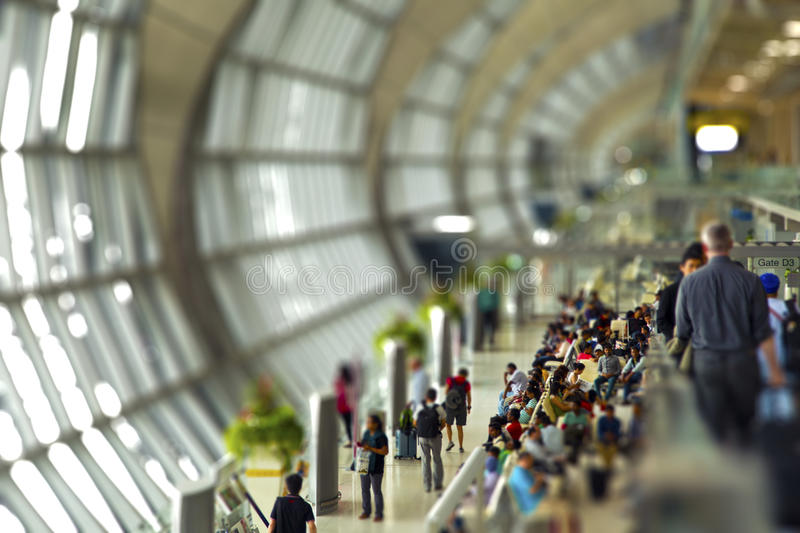 People queuing at a busy crowded airport stock photos
