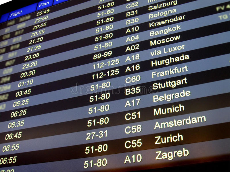 Airport delay sign, flight schedule, airline. The new airport flight schedule board sign showing the aeroplane flight number, status (go to gate, boarding, delay royalty free stock photos