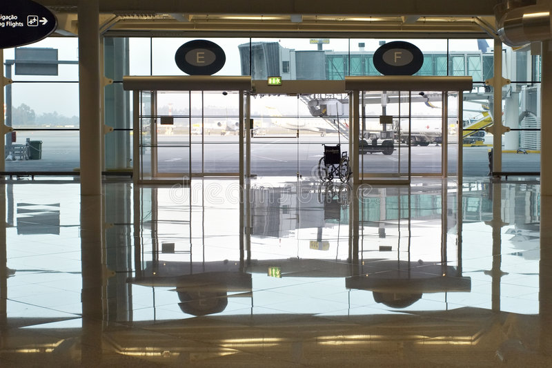 Airport doors. Modern airport interior with wheelchair; Porto; Portugal stock photography