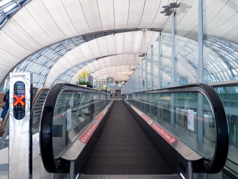 Airport escalator In the dome of a high roof. stock photos