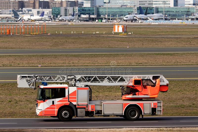 Airport fire fighter truck. An red airport fire fighter truck stock image