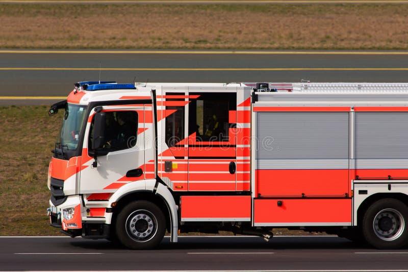 Airport fire fighter truck. An red airport fire fighter truck stock photos