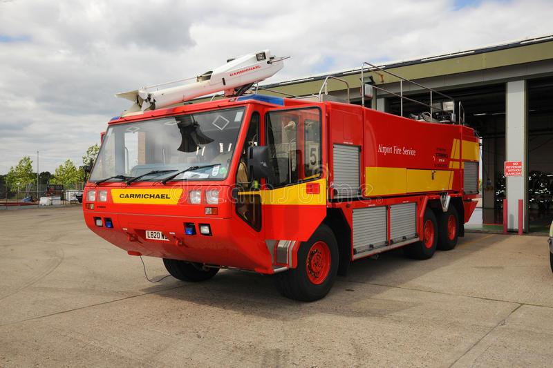 Airport Fire Tender on standby. Airport fire tender at Farnborough airport England royalty free stock image