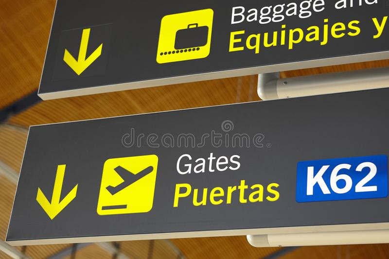 Airport flight arrival gates info display on spanish language. Horizontal royalty free stock image