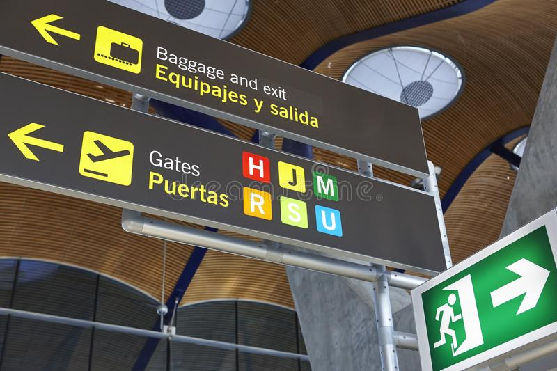 Airport flight arrival gates info display on spanish language. Horizontal royalty free stock photography