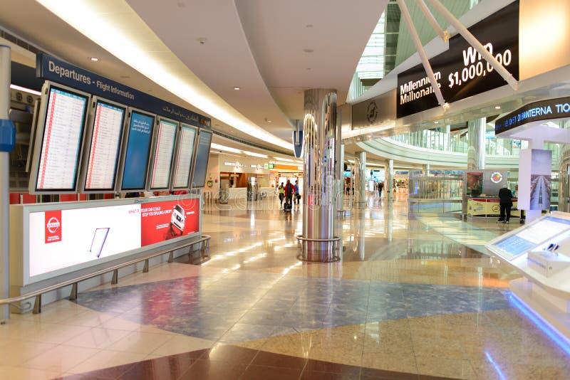 Airport interior. DUBAI, UAE - MARCH 31: flight schedule in airport on March 31, 2014 in Dubai. Dubai International Airport is an international airport serving royalty free stock photography