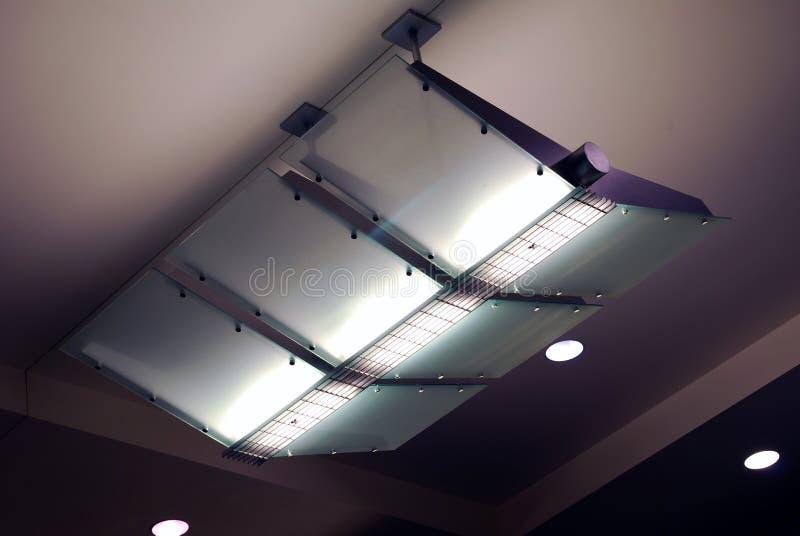 Airport light fixture overhead ceiling purple stock photos