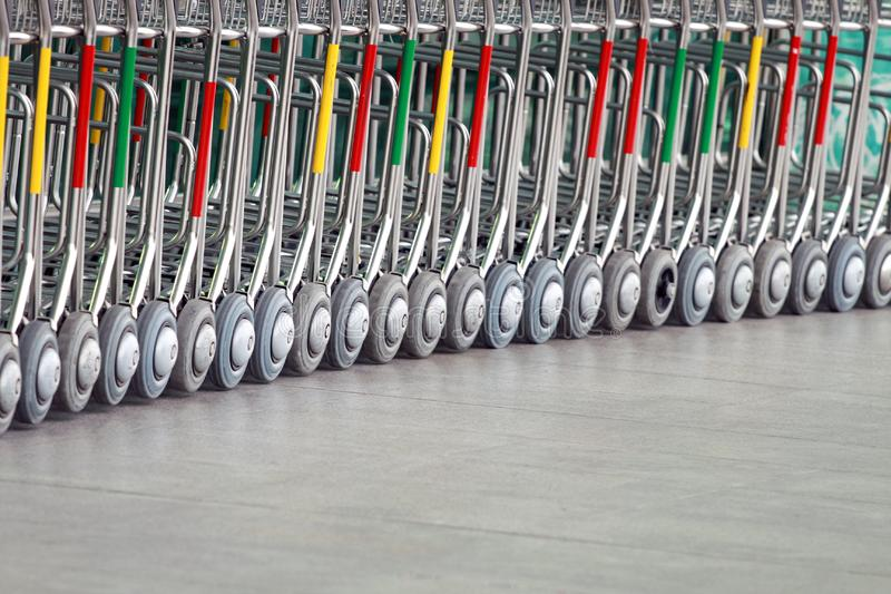 Airport Luggage carts. Stacked together in a row royalty free stock photo