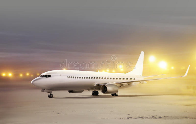 Airport at non-flying weather. White plane in airport at non-flying weather, blowing snow stock images