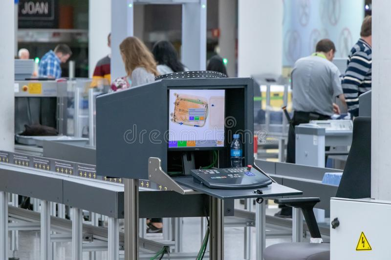 Airport, palma, mallorca, spain, 2019 april 14: monitor with x-ray of luggage royalty free stock images