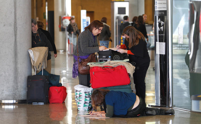 Airport passengers filling claims. Passengers and their belongings seen while filling claims due to delays during a major strike day in palma de mallorca´s royalty free stock photo