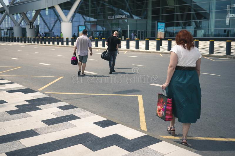 Airport Platov, Russia - 24.05.19: beautiful adult woman with red hair goes with the family to the airport royalty free stock photos