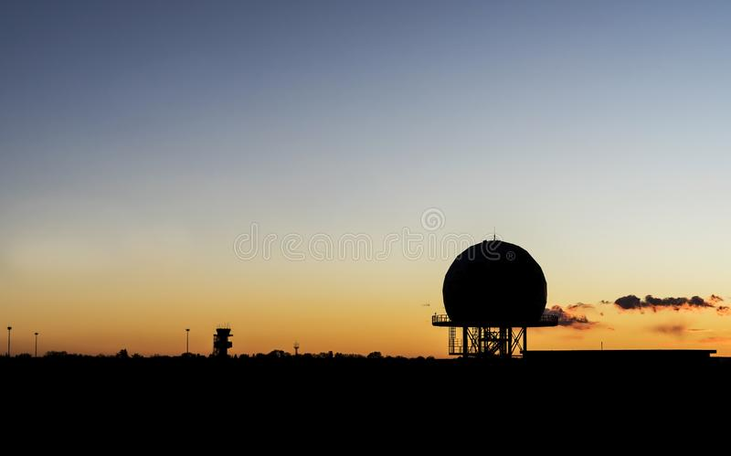 Airport radar tower low light silhouette royalty free stock photography