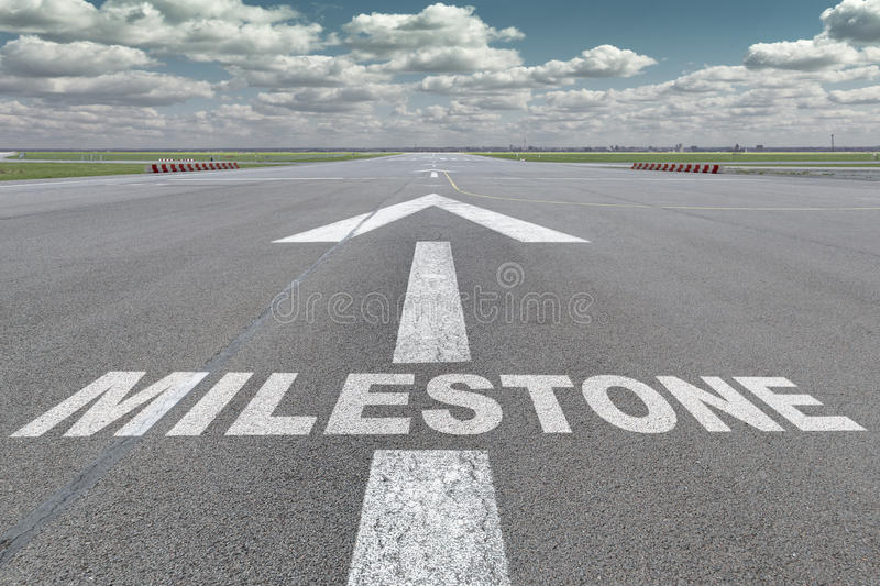 Airport runway arrow milestone. Runway of airport with arrow guideline and Milestone letters painted on the surface royalty free illustration