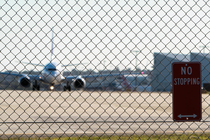 Airport security fence and sign. Airport security fence and 'keep out' sign royalty free stock photography