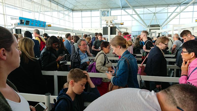Airport security. UK Airport security area. People lining up waiting to go through to the baggage scanning area. This picture shows the Stansted Airport security royalty free stock photography