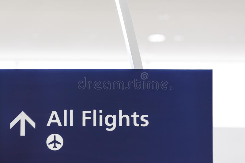 Airport sign with symbol of airplane and arrow showing direction. To boarding area gates. Air travel concept stock images