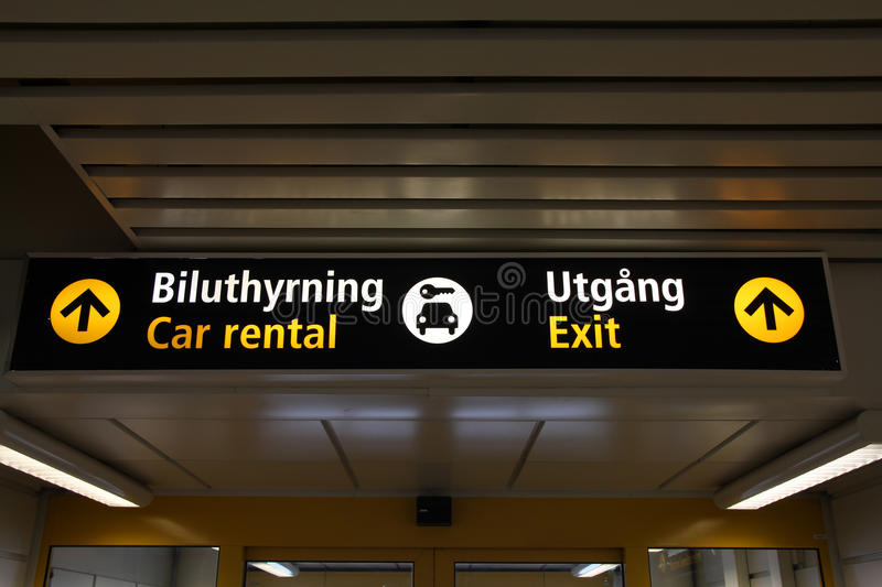 Airport signs. Typical illuminated directions sign in a modern international airport. Malmo Airport terminal - English and Swedish language royalty free stock images