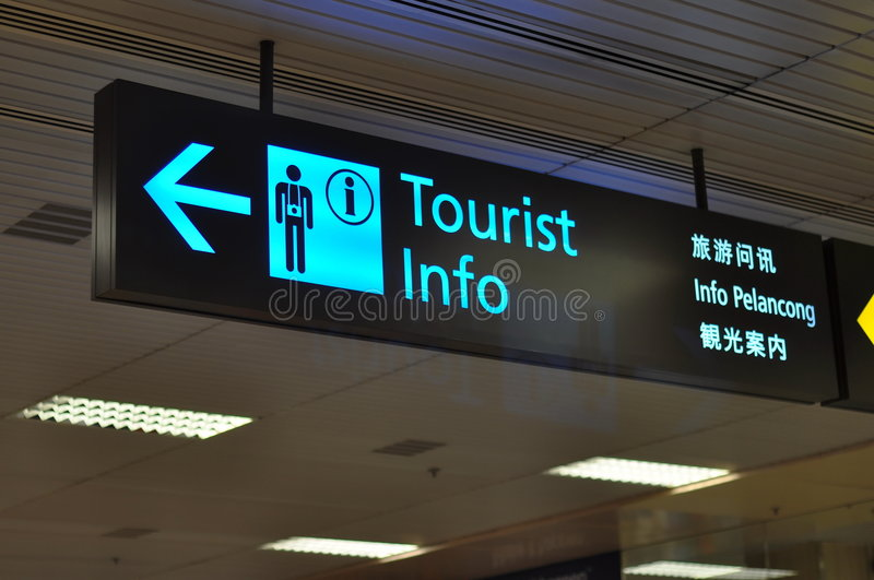 Airport signs. Tourist info signage in airport with multiple languages royalty free stock photography