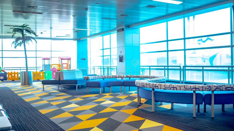 Airport terminal building with children playground facility. royalty free stock photography