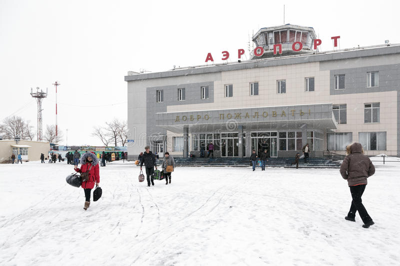 Airport terminal Petropavlovsk-Kamchatsky (Yelizovo airport) and station square with passengers. PETROPAVLOVSK-KAMCHATSKY, KAMCHATKA, RUSSIA - MARCH 19, 2015 royalty free stock photo
