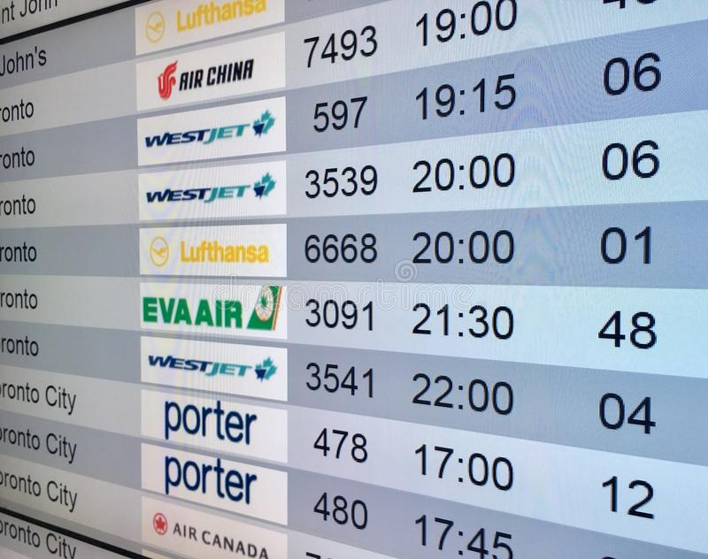 Airport timetable display. In Quebec Airport, Canada stock photography