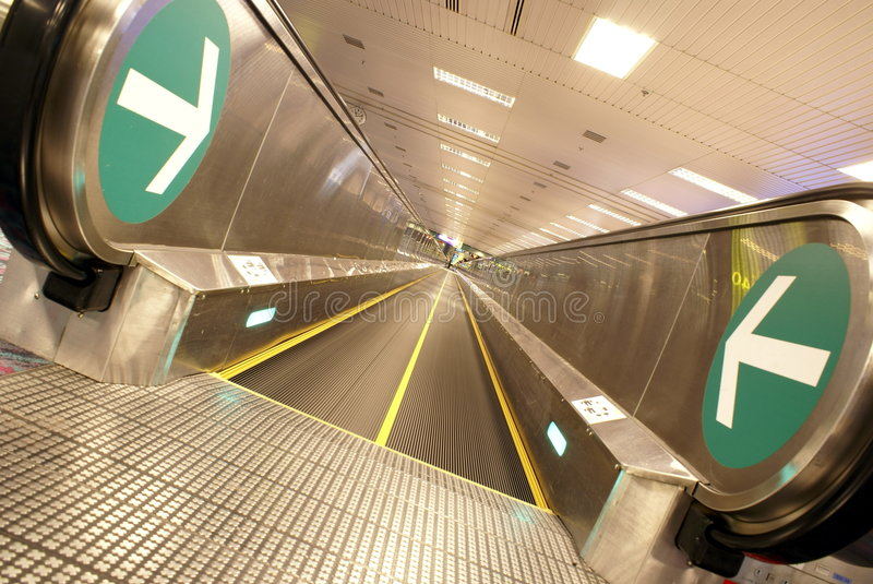 Airport travelator tilted. Airport travelator in horizontal format with tilted perspective royalty free stock photography