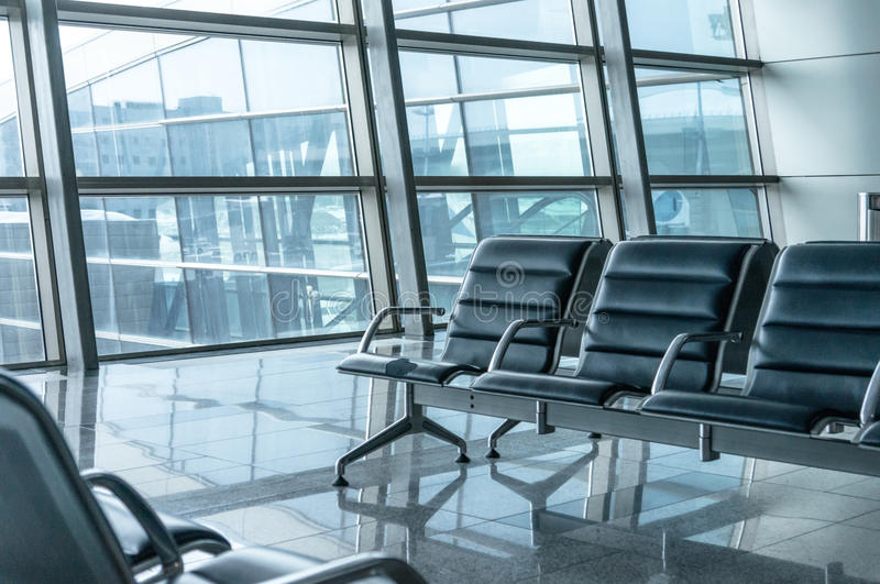 Airport waiting area. Seats and outside the window scene stock photo