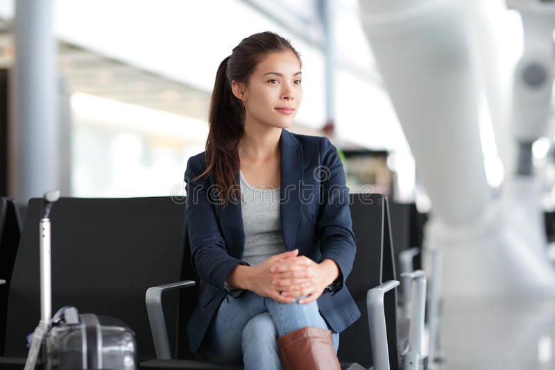 Airport woman waiting in terminal - air travel royalty free stock image
