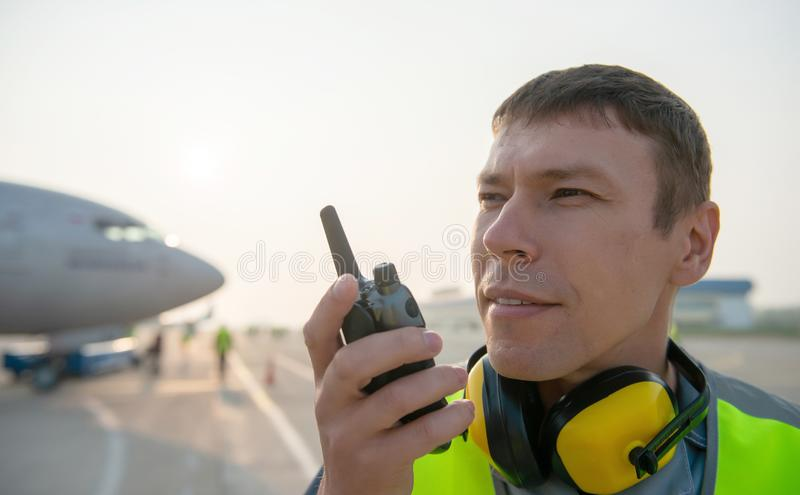 Airport worker man male maintenance aircraft airplane stock image