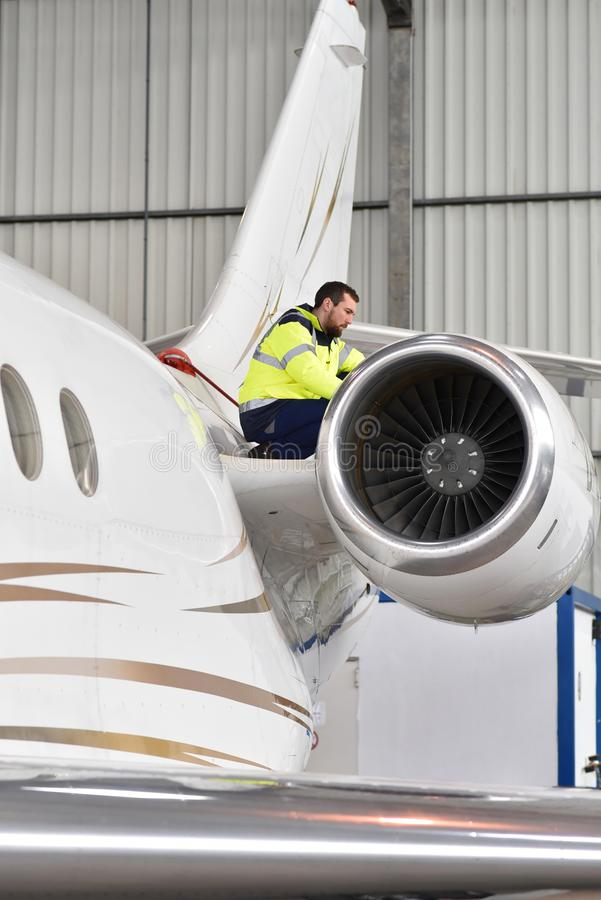 Airport workers check an aircraft for safety in a hangar. Closeup photo stock photo