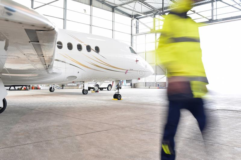 Airport workers check an aircraft for safety in a hangar. Closeup photo stock photography