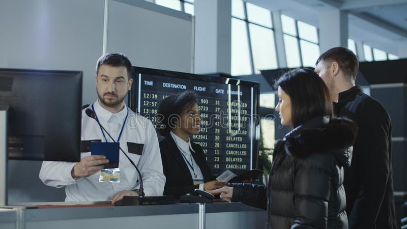 Airport workers checking documents at control point stock photography