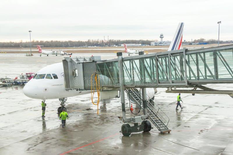 Airport workers (crew) are preparing for disembarking passenger. stock photo