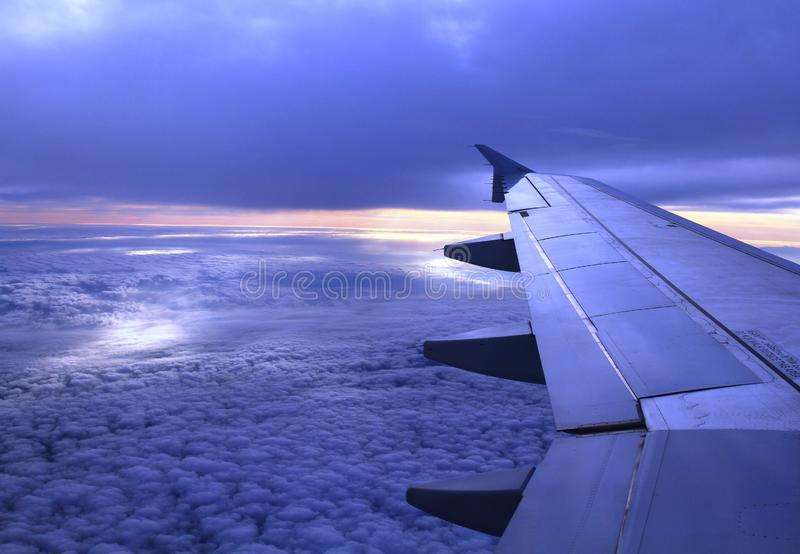 Sunrise from airplane stock photography