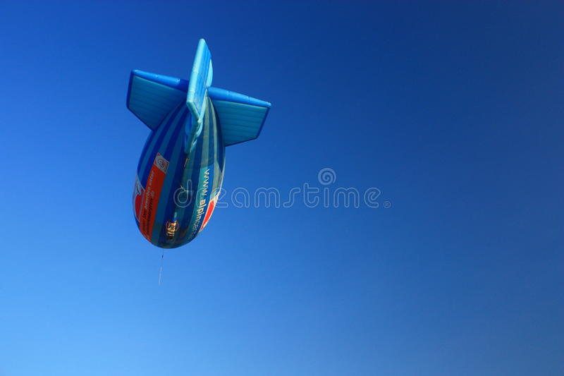 Airship shape hot air balloon with clear blue sky royalty free stock photo