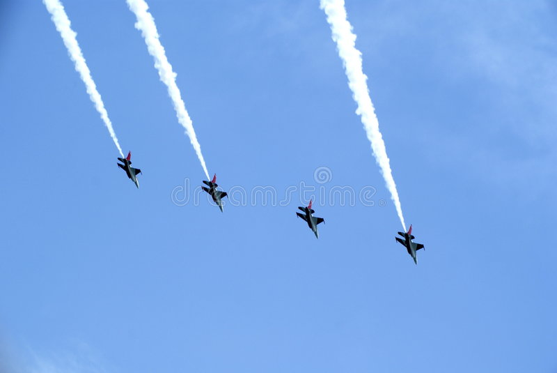 Airshow acrobatics smoke trail stock images
